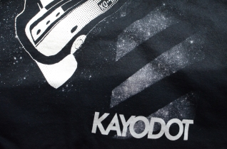 2-color Discharge Sim-Process Print on Gildan 2000 for the NY band, Kayo Dot (detail) - Really love the way the grey and white came together to get the depth of these space rays. Art by Toby Driver.